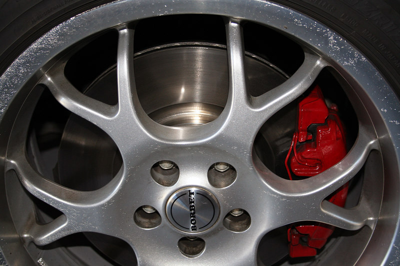 New front brakes.  The scratches were on the wheel when I bought the car.  Sign of too many automated car washes