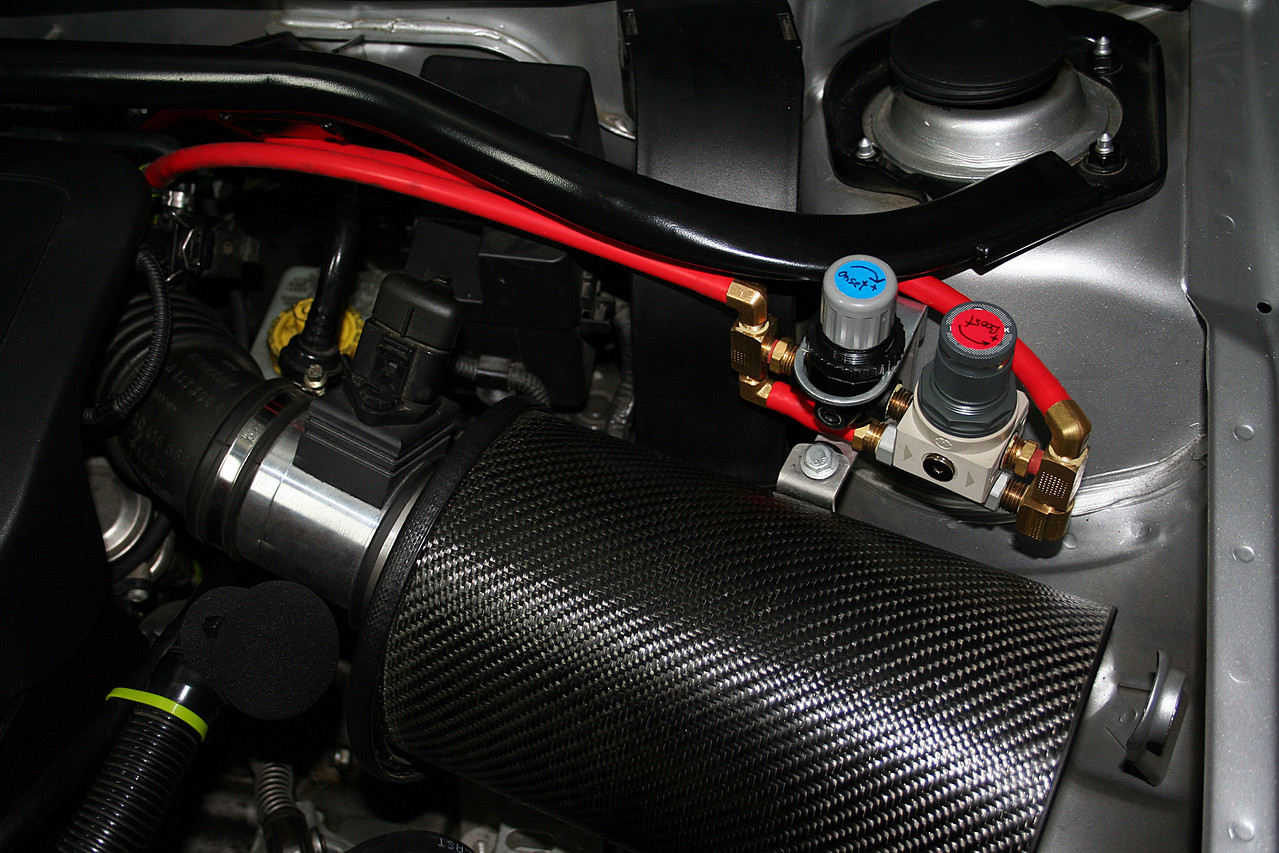 The engine compartment has been modified to Modshack phase III specs.  This includes a less restrictive mass air flow sensor, upgraded fuel pressure regulator, insulated carbon fiber VTDA w/K&N filter, Boost Machine (set for 20psi), Defi boost gauge (mounted in driver vent), Forge DV, and GIAC flashed ECU.