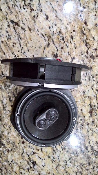 """Aftermarket speaker mounted to speaker adapter from <a href=""""http://car-speaker-adapters.com/items.php?id=SAK129""""> Car-Speaker-Adapters.com</a>"""