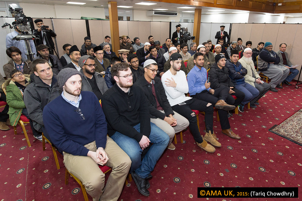 """The actual programme began earlier at 12.00 noon in the Mahmood Hall. The 95 new Ahmadis (men, ladies and children) in attendance were first given an introductory session by Mr Jonathan Butterworth {Additional Secretary Tarbiyyat & Waqfe Jadid for New Ahmadis}. Next Maulana Mansoor Clarke, gave a speech on """"Khilafat: The Truth of Our Beliefs"""". This was followed by a Question and Answer session. All the New Ahmadis went for Zohr and Asr prayers and then had lunch together. Special arrangements for lunch were made, by the New Ahmadi team, for all the participants."""