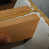 The solution:  a pair of 5/4 oak blocks mounted on either side of the MDF flange will give a solid something to screw the plate into.