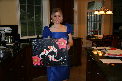 Audrey showing the painting she made for Ali