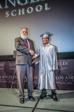 Ceremony two grads walking
