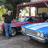 CATHY SPAULDING/Muskogee Phoenix<br /> Chuck Chastain shows off two Chevelles he restored. He said he enjoys Chevrolet cars because he understands them.