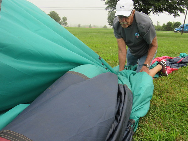 CATHY SPAULDING/Muskogee Phoenix<br /> Steve Libel of Marco Island, Florida, crawls along his Airhawk hot air balloon Saturday morning after foggy conditions prevented him and other teams from flying in the Oklahoma Festival of Ballooning.