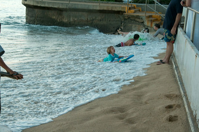 Kids enjoy the surf at Waikiki Beach