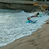 Kids enjoy the surf at Waikiki Beach