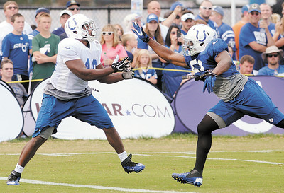 Don Knight | The Herald Bulletin Linebacker Henoc Muamba covers Mario Harvey during Colts practice at AU on Friday.