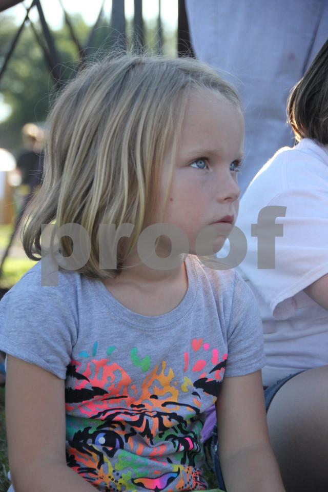 Abigail Brockman watches the  Gowrie Fire Department Truck and Tractor Pull  intently. The event was to raise money for the Gowrie's new Fire Station and took place at the Webster County Fairgrounds on Saturday, August 1, 2015.