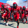 UL running backs Alonzo Harris (46) and Effrem Reed (31) lead the team onto the field prior to their matchup against Tulane in an NCAA football game on Saturday, Oct. 6, 2012.