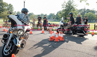 080216  Wesley Bunnell | Staff  New Britain Motor Unit Instructor Ofc. Joe Briganti, left, rounds an obstacle course with fellow Ofc. Danny McBride. National Night Out took place on Tuesday Aug 2nd from 5-7pm at Walnut Hill Park. The event is part of a community-police awareness event across the country to strengthen common bonds.