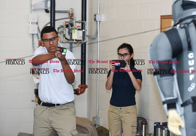 080216  Wesley Bunnell | Staff  Jordan Wallace, a rising sophomore from Public Safety Academy aims a taser gun at the target. High school age students from around the state are taking part in a leadership academy at New Britain Police Headquarters this week.