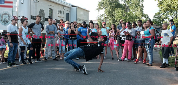 080216  Wesley Bunnell | Staff  Hip hop dancer Tyler Robert Johnson who goes by the dancer name CPHH performs in front of a crowd. National Night Out took place on Tuesday Aug 2nd from 5-7pm at Walnut Hill Park. The event is part of a community-police awareness event across the country to strengthen common bonds.