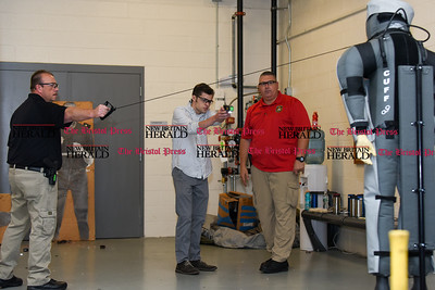 080216  Wesley Bunnell | Staff  Rising senior from Canton High School Josh Copell fires a taser gun on a target with New Britain Police training instructor Robert Paciotti, left, and firearms supervisor Tom Grey.  High school age students from around the state are taking part in a leadership academy at New Britain Police Headquarters this week.