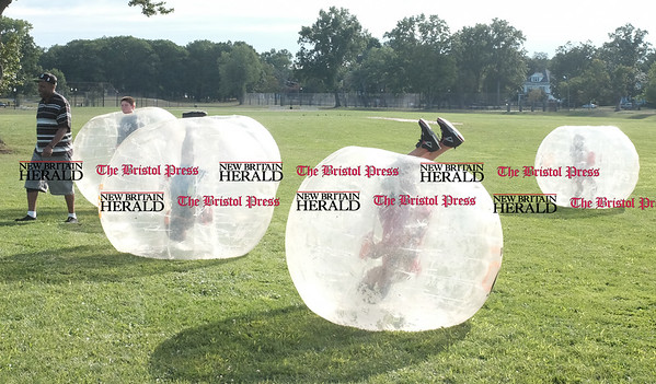 080216  Wesley Bunnell | Staff  Children participated in a game of Knocker Ball in inflatable bubbles. National Night Out took place on Tuesday Aug 2nd from 5-7pm at Walnut Hill Park. The event is part of a community-police awareness event across the country to strengthen common bonds.