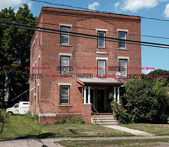 080416  Wesley Bunnell | Staff  Properties located on West Main St. have been the subject of blight enforcement.