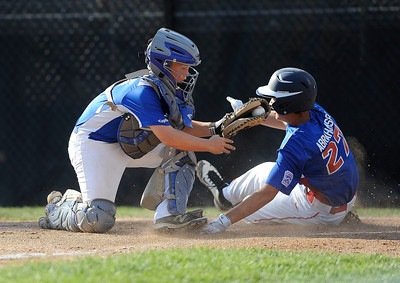 8/9/2016 Mike Orazzi | Staff New Jersey's John Abrahamsen (27) tagged out at home by Pennsylvania's Cy Probst (26) during the Eastern Regional Little League Tournament at Breen Field in Bristol Tuesday.