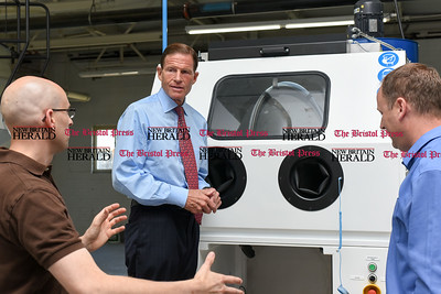 081516  Wesley Bunnell | Staff  Senator Richard Blumenthal stands with Vice President of Addaero Manufacturing David Hill, left, & President Rich Merlino on the shop floor. Senator Blumenthal visited Addaero  in New Britain on Monday afternoon.