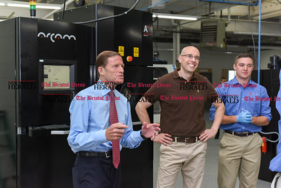 081516  Wesley Bunnell | Staff  Senator Richard Blumenthal stands with Vice President of Addaero Manufacturing David Hill, middle, & material engineer John Scoville, right on the shop floor. Senator Blumenthal visited Addaero  in New Britain on Monday afternoon.