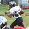 081716  Wesley Bunnell    Staff<br /> <br /> Elijah Dority with a rushing attempt during practice with the New Britain Police Athletic League's Raiders Junior Pee Wee D team.  PAL, held cheerleading & football practice on Wednesday evening at Al Beatty Memorial Field.