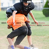 081716  Wesley Bunnell    Staff<br /> <br /> Omarion Figueroa in black being blocked by David Lockhart during the New Britain Police Athletic League's Raider Junior Pee Wee D team practice. PAL, held cheerleading & football practice on Wednesday evening at Al Beatty Memorial Field.