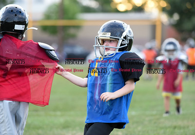 081716  Wesley Bunnell  | Staff  Justin Booker of the New Britain Police Athletic League Tiny Mites Raiders football team grabs hold of a team mates jersey during practice. PAL, held cheerleading & football practice on Wednesday evening at Al Beatty Memorial Field.