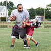 081716  Wesley Bunnell    Staff<br /> <br /> Coach Miguel Merced of the New Britain Police Athletic League is held up by player and son Miguel Merced Jr during practice. PAL, held cheerleading & football practice on Wednesday evening at Al Beatty Memorial Field.