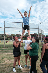 081716  Wesley Bunnell  | Staff  Cheerleaders of the New Britain Police Athletic League's A-1 Raiders football practice their routines. From L Natalee Cruz, Mercedes Ellison & Meajah Edney hold Kaylah Theriault in the air. PAL, held cheerleading & football practice on Wednesday evening at Al Beatty Memorial Field.