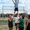 081716  Wesley Bunnell    Staff<br /> <br /> Cheerleaders of the New Britain Police Athletic League's A-1 Raiders football practice their routines. From L Natalee Cruz, Mercedes Ellison & Meajah Edney hold Kaylah Theriault in the air. PAL, held cheerleading & football practice on Wednesday evening at Al Beatty Memorial Field.