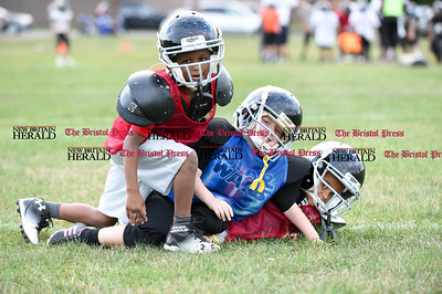 081716  Wesley Bunnell  | Staff  From left Jonathan Martinez, Justin Booker and Miguel Merced of the New Britain Police Athletic League Tiny Mites Raiders football team have pile on each other during practice. PAL, held cheerleading & football practice on Wednesday evening at Al Beatty Memorial Field.