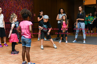 "081816  Wesley Bunnell  | Staff  Participants in the the New Britain Library's Hip-Hop Dance Workshop taught by Justin ""JuS"" Hues perform for the crowd at the New Britain Museum of American Art. The annual Library Arts Showcase which is funded by the Community Foundation of Greater New Britain was held on Thursday evening."