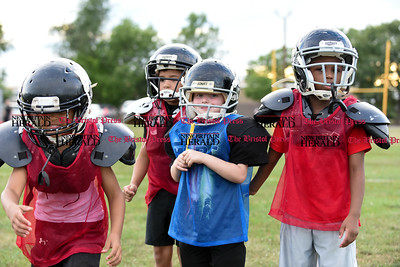 081716  Wesley Bunnell  | Staff  The New Britain Police Athletic League Tiny Mites Raiders football team shown from left include Anthony Campbell, Jonathan Martinez, Justin Booker & Dante Bell Jr. PAL, held cheerleading & football practice on Wednesday evening at Al Beatty Memorial Field.