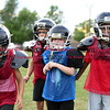 081716  Wesley Bunnell    Staff<br /> <br /> The New Britain Police Athletic League Tiny Mites Raiders football team shown from left include Anthony Campbell, Jonathan Martinez, Justin Booker & Dante Bell Jr. PAL, held cheerleading & football practice on Wednesday evening at Al Beatty Memorial Field.