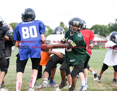 081716  Wesley Bunnell  | Staff  Cayden Hill of the New Britain Police Athletic League's Raiders Junior Pee Wee D team fakes the hand off during practice. PAL, held cheerleading & football practice on Wednesday evening at Al Beatty Memorial Field.