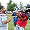 081716  Wesley Bunnell    Staff<br /> <br /> Coach Miguel Merced of the New Britain Police Athletic League Tiny Mites Raiders football has the ball stripped by Jonathan Martinez. PAL, held cheerleading & football practice on Wednesday evening at Al Beatty Memorial Field.