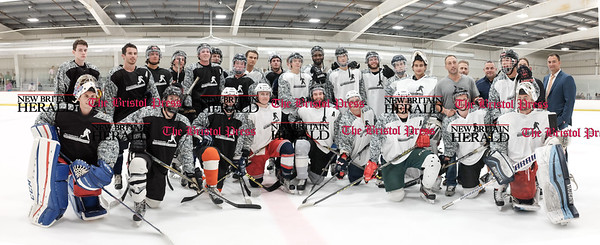 081916  Wesley Bunnell  | Staff  Composite photo of both Black & White teams at Pete Asadourian's 12th annual Pro Hockey Camp Scrimmage. The Black Team was captained by Nick Bonino & the White Team captained by Jordan Samuels-Thomas. The game took place on Thursday evening at Newington Arena.