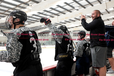 081916  Wesley Bunnell  | Staff  Coaches and players #3 Garrett Sundqvist, shown left, cheer after scoring a game tying goal late in regulation to force overtime. Pete Asadourian's 12th annual Pro Hockey Camp Scrimmage took place on Thursday evening at Newington Arena.