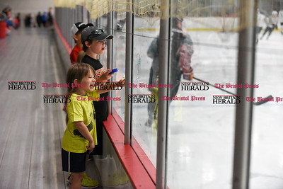 081916  Wesley Bunnell  | Staff  Max Sandler of Glastonbury is all smiles as he points to his favorite hockey players at Pete Asadourian's 12th annual Pro Hockey Camp Scrimmage on Thursday evening at Newington Arena.