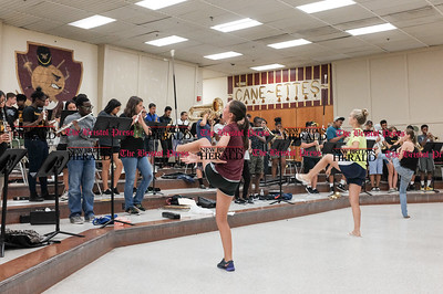 082216  Wesley Bunnell | Staff  Band practice is underway at New Britain High School before the official start of school. Band members, color guard and the Cane-Ettes all practiced this Monday afternoon.  Practicing the baton as the band plays are from left, Cate Keithline, Ava Morell and Taylor Smith.