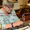 080816  Wesley Bunnell | Staff<br /> <br /> Lidia Jasinski measures materials to be cut in preparation for the Senior Center's Craft Fair this October. Seniors at the Bristol Senior Center are busy making crafts every Monday.