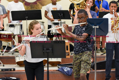 082216  Wesley Bunnell | Staff  Band practice is underway at New Britain High School before the official start of school. Band members, color guard and the Cane-Ettes all practiced this Monday afternoon. Band members are shown practicing under the guidance of Dr. David Kayser.