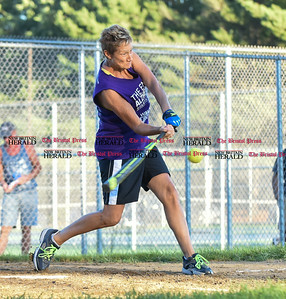 082216  Wesley Bunnell | Staff  Capitol Transmission Women's softball team wore purple to honor Mary Ann Steadman, the mother of Kimberly Meucci, one of the players. Steadman recently passed away of Alzheimer's. Purple represents the color of the Alzheimer's Foundation.