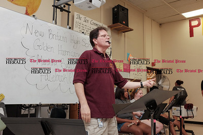 082216  Wesley Bunnell | Staff  Band practice is underway at New Britain High School before the official start of school. Band members, color guard and the Cane-Ettes all practiced this Monday afternoon.  Dr. David Kayser leads the band in practice.