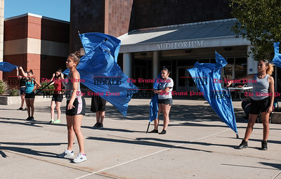 082216  Wesley Bunnell | Staff  Band practice is underway at New Britain High School before the official start of school. Band members, color guard and the Cane-Ettes all practiced this Monday afternoon. Junellie Vasquez shown on the left practices her flag routine.