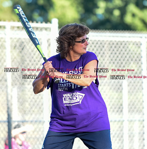 082216  Wesley Bunnell | Staff  Capitol Transmission Women's softball team wore purple to honor Mary Ann Steadman, the mother of Kimberly Meucci, one of the players. Steadman recently passed away of Alzheimer's. Purple represents the color of the Alzheimer's Foundation.  Kimberly Meucci is shown.