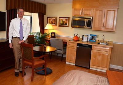 3/31/2015 Mike Orazzi | Staff Village Green Executive Director Jim Dahl in one of the suite rooms.