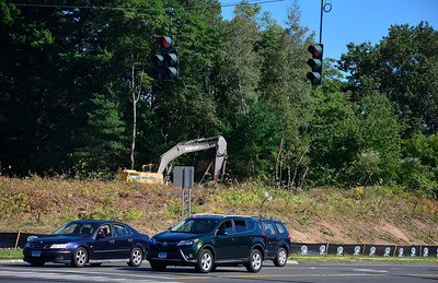 8/23/2016 Mike Orazzi | Staff Trees being removed from a lot at the intersection of Pine and Emmett Streets in Bristol Tuesday.