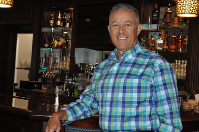 8/22/2016 Eve Britton | Staff Juan Rodriguez, general manager Chippanee Golf Club stands by the mahogany bar.