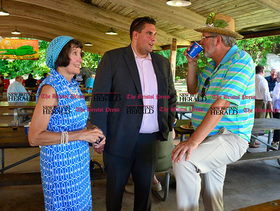 8/26/2016 Mike Orazzi | Staff Susan Sterniak and Pat Kilby talk with Bill Petit during the 135th Crocodile Club Reunion Dinner held at Lake Compounce Friday afternoon.
