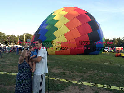 8/26/2016 Mike Orazzi | Staff Angela and Kevin DeAngelo with their son Carson during the annual Plainville Balloon Festival.